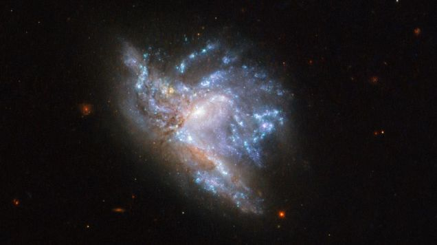 Check Out This Incredible New Hubble View of Two Galaxies Smashing Together